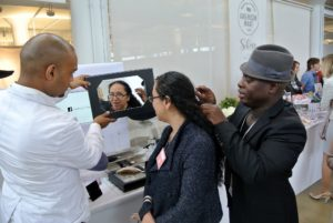 Here is Anthony advising a shopper on how to attach one of his beautiful headpieces for an upcoming special event.