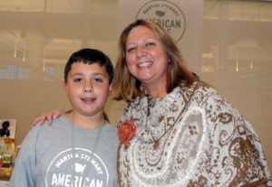 Kim Miller-Olko with her son, Ethan, who volunteered to help his mom for the long 13-hour day.