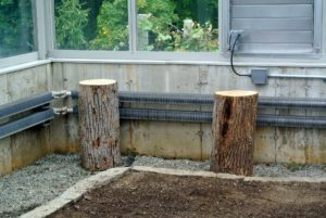I wanted the taller logs to be on the perimeter - these logs are very secure in the gravel - they won't go anywhere.