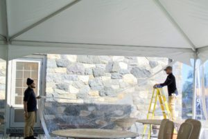 The crew from Greenwich Tent Company returned to attach the clear, vinyl walls to the tent. Because the weather was expected to be mild, we didn't plan for walls; however, attaching them prevents birds from entering the space overnight.