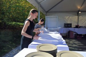 Members of the wait staff from Parella Events fold the napkins for each table.