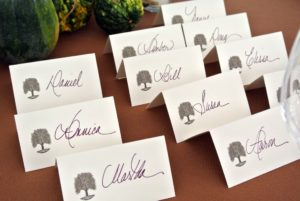 Place cards also display the great sycamore symbol.