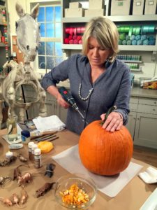 Use an electric drill with a one and a half inch drill bit, and make holes around the pumpkin - watch our Facebook LIVE from last week to see how I did this. This great idea is from our October issue of Living.