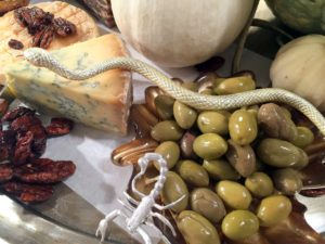 This friendly snake is slithering through our olives and atop our cheese.