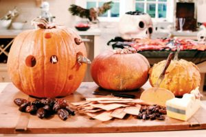 On the counter, we decorated this cheese board with pumpkins - one hallowed out and filled with scary mice.