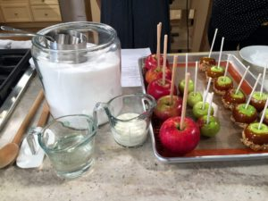 If you're having a Halloween party why not make some delicious caramel apples? My recipe os so easy. The ingredients include apples, sugar, corn syrup and whatever you'd like to use for the toppings. http://www.marthastewart.com/925884/caramel-apples