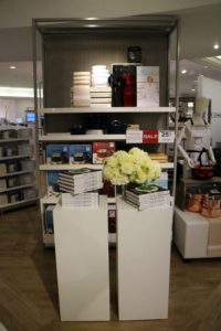 Behind this book display is our outpost featuring different sizes of our Enameled Cast Iron pot selection and other kitchen must-haves.