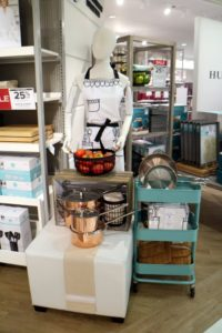 Here are our Copper Cookware sets, our Whim Pencil Sketch apron, and various wooden cutting boards.