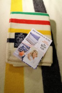 The Hudson's Bay Company continues to sell the iconic Hudson's Bay point blanket, a type of wool blanket traded in Canada and the United States during the 18th and 19th centuries.