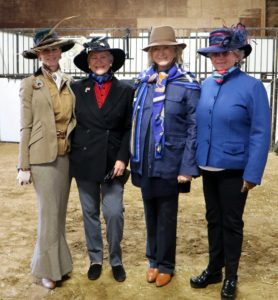 Four of us stop for a quick photo before the ride. I am standing with Kelly Casella, Carol, and Mary.