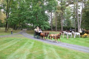 Walter and Ted Ayers are driving their four polo ponies. In keeping with Gilded Age tradition, each Coach carries two grooms to assist the horses and serve the passengers.