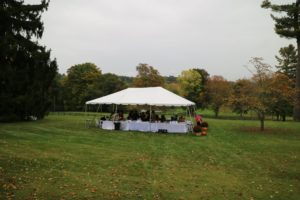 The Coachmen enjoy lunch in the tent that overlooks pastures and the Stockbridge golf course.