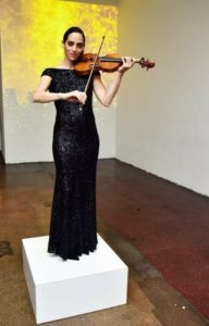 A violinist played music to welcome guests as they entered the venue. (Photo by Sean Zanni for Patrick McMullan)