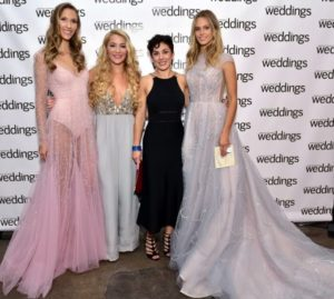 Models, Marloes Stevens and Candice Zagorsk, stop to take a photo with designer Hayley Paige and our own editor-in-chief of Weddings, Amy Conway.  (Photo by Sean Zanni for Patrick McMullan)