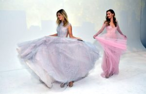 A big trend for weddings is the growing number of colored gowns - brides are taking more chances with color. Here are models Marloes Stevens and Candice Zagorski in their Hayley Paige dresses. (Photo by Sean Zanni for Patrick McMullan)