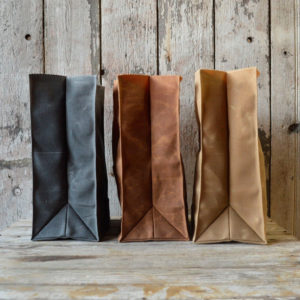 These Peg + Awl Marlowe Lunchbags are reusable lunch bags made from waxed canvas.