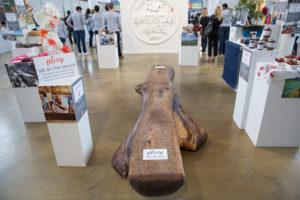 """Honoree NYCitySlab is dedicated to saving fallen trees and recycling the wood. This beautiful log bench stirred lots of conversation during the event! A sign was added inviting attendees to """"Please Sit on Me"""". http://www.nycityslab.com (Photo by Mike Krautter)"""