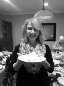 Associate product manager, Samantha Perlman, submitted this photo of her Aunt Claire, who hosted the family gathering. Aunt Claire is holding a sculpted butter turkey!