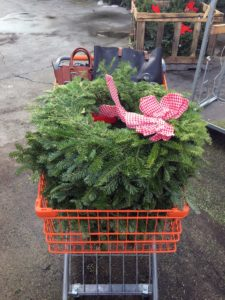 """Every year, on """"Black Friday"""", Claire, her mom, and her aunt, go to The Home Depot to stock up on the wreaths on sale. Eventually, the wreaths are decorated with personal ribbons and ornaments."""