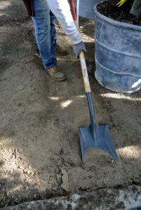 Wilmer goes over the same paths with a shovel to make them more defined and tidy.