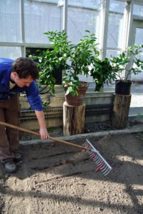 Ryan uses this bed preparation rake from Johnny's Selected Seeds to create furrows in the soil. Hard plastic tubes slide onto selected teeth of the rake to mark the rows. http://www.johnnyseeds.com/