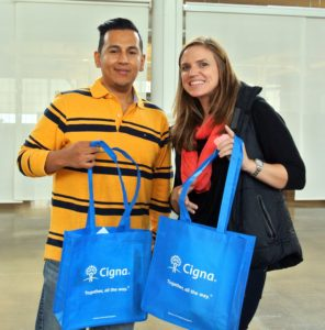 IT System Administrator, Angelo Cardenas, and IT Director of Application Development, Sonya Nguyen, received information packets and handy totes from our friends at Cigna.