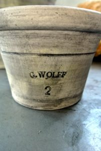 At the bottom side of his pots, Guy stamps his name and the wet weight of the clay used. This standardized system for marking horticultural pots was adopted by Victorian potters.
