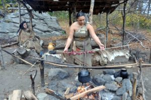 The women roast directly over the pit. Here, this woman is cooking venison. The Wampanoag did not have set meal times - they snacked all day, whenever they got hungry.