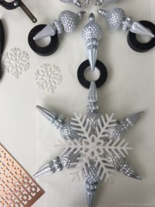And do you have a Christmas tree topper? This snowflake topper is made using several of our Winter Tidings ornaments. The easy how-to is on our Facebook LIVE.