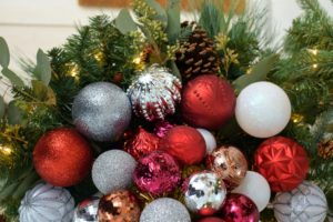 I love our colorful palette of festive holiday decorations. These are our Winter Tidings Shatter Resistant Ornaments - they are red, silver, copper, textured and smooth.