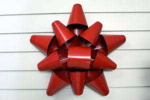 This is one of our favorites - the 19-inch Red Metal Bow - a perfect touch for above the entryway or the fireplace. It comes in red and in silver - both are so pretty.