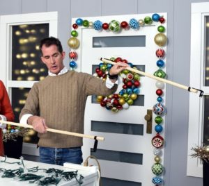 Use dowels like these or curtain rods to attach lights to hang from your window.