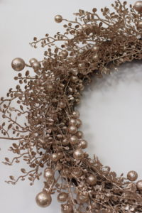 This is among my favorite wreaths - the Chmpagne Berry Wreath. And, what I love most about it is that it can be displayed even after Christmas.