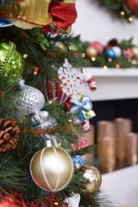 This collection includes lots of red, gold, silver and green ornaments.