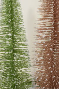 Our classic Shimmering Bottle Brush Trees come in silver, green and copper with round resin bases.