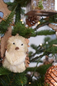 Our Sisal Hedgehog ornaments are symbols of spring and rejuvenation. These come in sets of two with one standing and one sitting up, both with pinecone-like quills and furry fronts.
