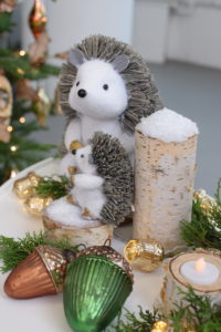 "Kevin and I showed how to make the birch bark votives, and these cute ""snow"" covered stumps. It's such an easy project - see it on our Facebook LIVE. The Hedgehog Family Figurines can sit right on top of the wintery stumps all season long."