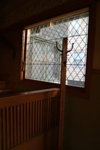 Here is a diamond-paned leaded glass window - simple yet so elegant.