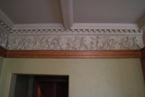 The plaster frieze in the entrance hall is a scale copy from the Ancient Greek altar of Pergamon. Commercially available via catalogue, the frieze was one of the many beautiful objects that Wright used to create an inspiring and nurturing environment for his family.