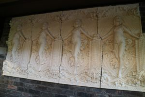 The frieze above the fireplace is a copy of the original that hung in its place. Designed by Wright for the Isidore Heller house (1896) in Chicago, it comprises a repeating panel depicting a classical maiden framed by Sullivanesque ornament. The frieze was sculpted by Richard Bock.