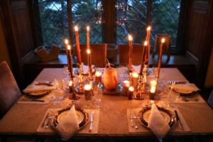 Our finished table set for six looks so beautiful all lit up in front of the leaded window.