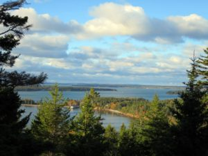 This is a beautiful autumn view of Seal Harbor as seen from the terrace at Skylands. Notice that most of the boats have disappeared from their harbor moorings? Sutton Island is in the distance - a small, private island south of where I am on Mount Desert. One never tires of seeing this view.
