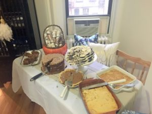 """This is our dessert table after guests started digging in. Many of the desserts were traditional southern treats including lemon chiffon ice box pudding and the classic chocolate wafer ice box cake. We also had a pumpkin pie, German chocolate cake, a French pineapple cake (prepared by one of Jurrie's French co-workers), and hazelnut brownies."""