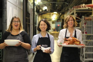 Here's the team bringing out the beautiful turkey and gravy. (Photo by Laura Manzano)