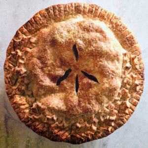 """Jason Schreiber, a chef from our test kitchen, sent in a beautiful photo of his apple pie. He added, """"I figured with all the strife in the world this season, even our apple pie needed to show some love. Heirloom apples, vanilla bean, and caramel made from the juice of the macerated apples inside. I celebrated Thanksgiving with my family in New York."""""""