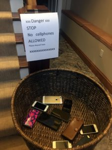 All the phones are placed in a basket until after the feast.