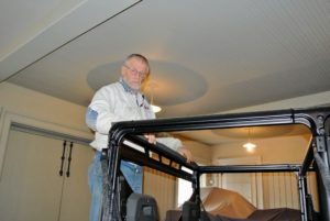 Dominic installs rubber seals first, to ensure the roof is secure and to prevent leaking into the cab of the vehicle.