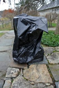 Because stone and cement are porous and sensitive to harsh elements, the urns are first covered with plastic. Heavy duty trash bags fit perfectly over these smaller vessels.