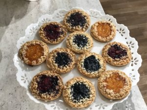 Place the cookies in a single layer on a decorative tray or cake stand - the colors are so festive, and you can use any jam you like.