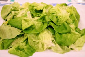 Bibb lettuce, also known as Boston, butterhead, or limestone lettuce, is a leafy green that's known for its distinctive creamy flavor and crisp, crunchy texture.